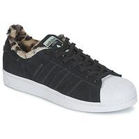 Cipők Női Rövid szárú edzőcipők adidas Originals SUPERSTAR W Fekete