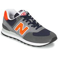 Cipők Férfi Rövid szárú edzőcipők New Balance 574 Szürke / Narancssárga
