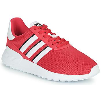 Cipők Lány Rövid szárú edzőcipők adidas Originals LA TRAINER LITE J Rózsaszín