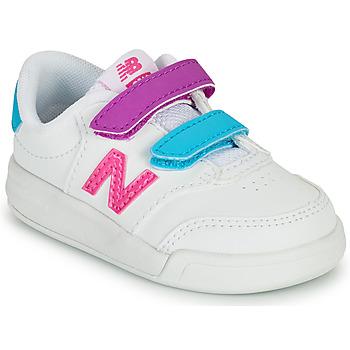 Cipők Lány Rövid szárú edzőcipők New Balance COURT Fehér / Rózsaszín