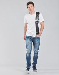 Ruhák Férfi Egyenes szárú farmerek Calvin Klein Jeans SLIM TAPER Kék / Átlagos