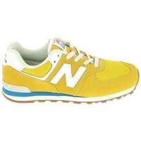 Cipők Gyerek Rövid szárú edzőcipők New Balance GC574 Jr Or Bleu Arany